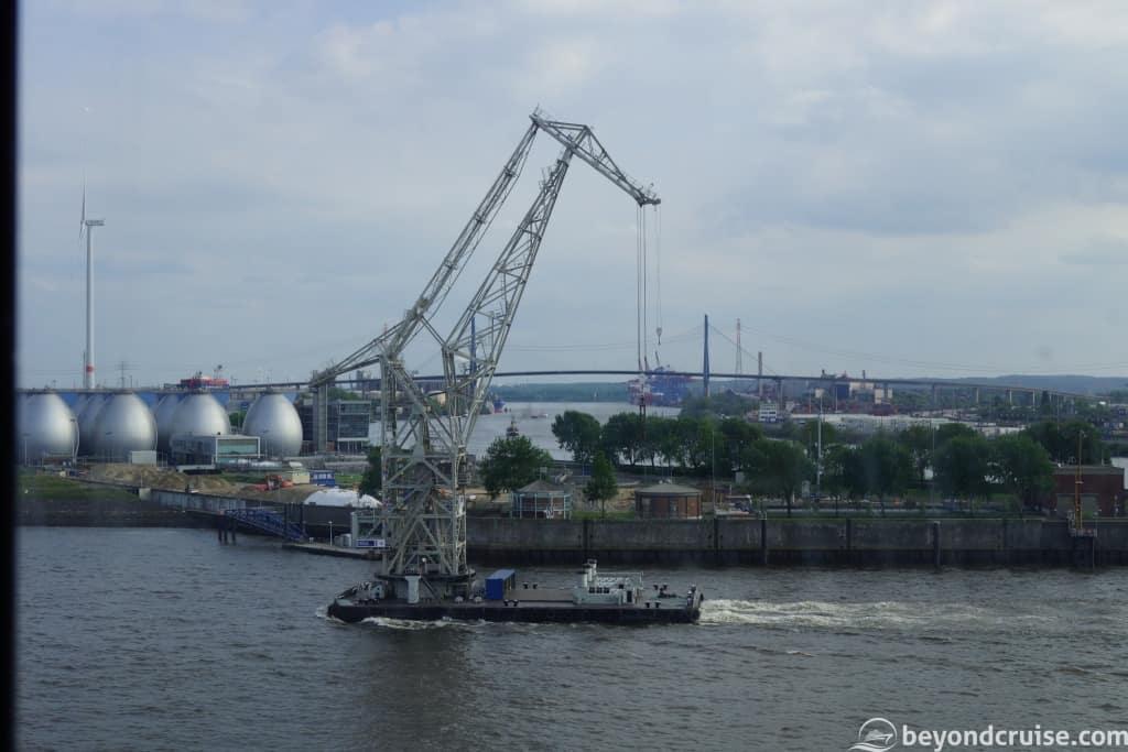 Mobile crane sails down River Elbe, Hamburg